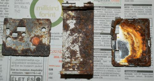 The removed rusted metal parts